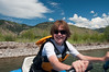 Maya piloting 8-person raft on Snake River. She's doin what she does best - having fun!