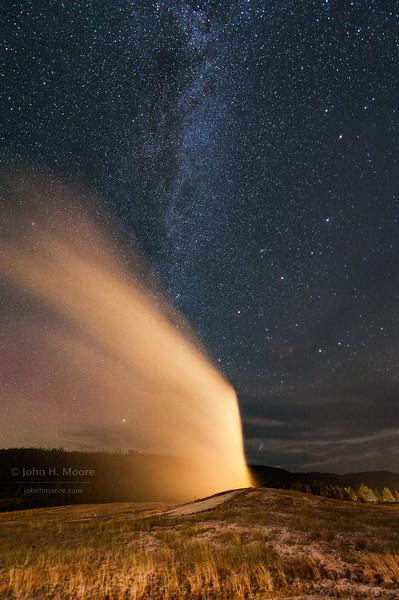 Old Faithful Geyser erupting at night.  Yellowstone National Park, Wyoming, USA.