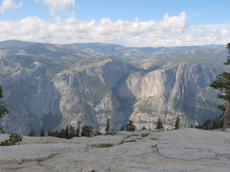 If Yosemite Falls had any water flowing you would see it directly across the valley just to the right of the angular shadow.