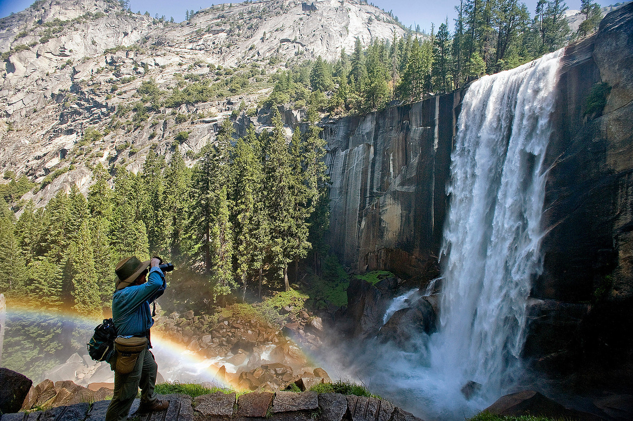 "This was taken by an Orange County Register photographer there with an OCR reporter who was interviewing visitors.  Jebb was kind enough to send me a copy.<br /> <br /> ""John Flippin of Yucaipa, Ca. pauses to photograph a glowing rainbow and Vernal Fall on the Merced River in Yosemite National Park in June, 2013. The popular Mist trail which leads past Vernal Fall to Half Dome sees approximately 2,000 hikers a day."" <br /> <br /> ///ADDITIONAL INFO ////  JEBB HARRIS ORANGE COUNTY REGISTER  -  yosemite.hantavirus.0625.jah  - shot: <br /> 6/18/13 --   /// <br /> Last year's fatal outbreak of hantavirus has not kept crowds from enjoying the beauty of Yosemite National Park. The popular Mist  trail which leads to Half Dome sees approximately 2,000 hikers a day. Every year recently fatalities have occurred when hikers entered swift waters of the Merced River and drowned or were swept to their death over waterfalls. Four million visited the park in 2012."