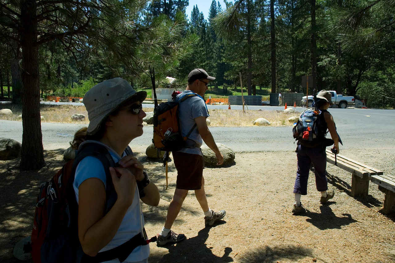 Corey adjusts her pack as Paul and Gina head for the bench while we wait for the shuttle in Wawona.