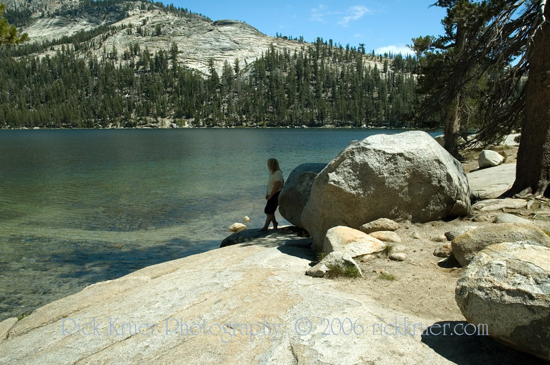 Nice, calm photo of Eileen silhouette against Tenaya Lake in the Yosemite wilderness.<br /> <br /> ND70_2006-07-29DSC_6373-EileenRelaxingTenayaLakeRocks-4 copy.jpg