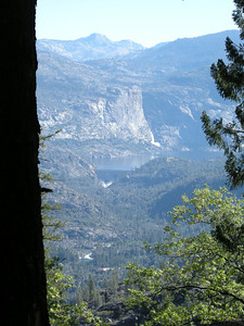 First view of Hetch Hetchy along the approach road. Visible is Lower Wapama Fall, Tueeulala Fall, O'Shaunessey Dam, and Hetch Hetchy reservoir. Mist at the base of the dam is due to water release.