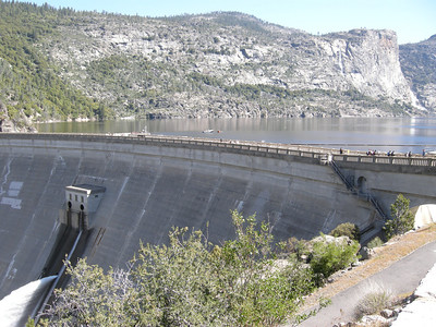 From the parking area: O'Shaunessey Dam and Hetch Hetchy reservoir. To the right in the distance are seen the thin thread of Tueeulala Fall and the base of Wapama Falls.