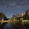 The Milky Way rises over Bridalveil Falls, El Capitan, and the Merced River in Yosemite Valley on a partial moonlit night.  Yosemite National Park, California, USA.