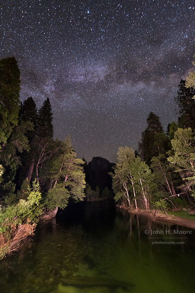 The Milky Way over Half Dome from Sentinel Bridge in Yosemite National Park.  California, USA.