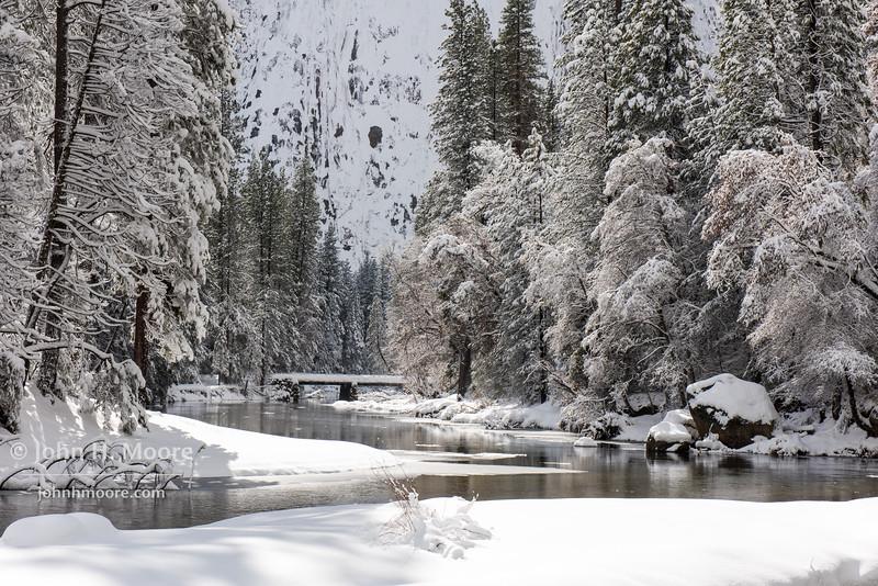 A bridge crosses the Merced River in Yosemite Valley