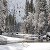 A bridge crosses the Merced River in Yosemite Valley
