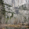 Dry Yosemite Falls behind the Merced River