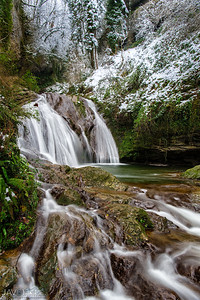 Gorgeous living water sculpture created by a mountain stream