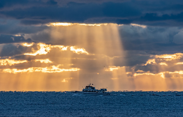 Fishing Boat In Front of Sun Rays Breaking Through The Clouds 10/18/18