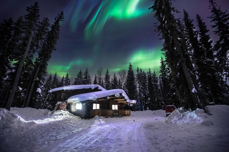 Joshua D Weiss Fine Art Photography of Alaskan Cabin under the Northern Lights