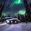 Joshua D Weiss Fine Art Photography of Alaskan Cabin under the Northern Lights