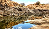 granite mountain lake reflecting pond drought season water levels