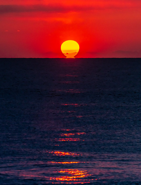 The Sun Tearing Away From The Horizon And Reflecting In The Ocean 4/16/20