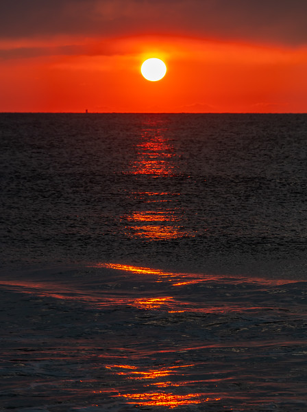 A Colorful Sunrise Reflecting In The Ocean 4/16/20