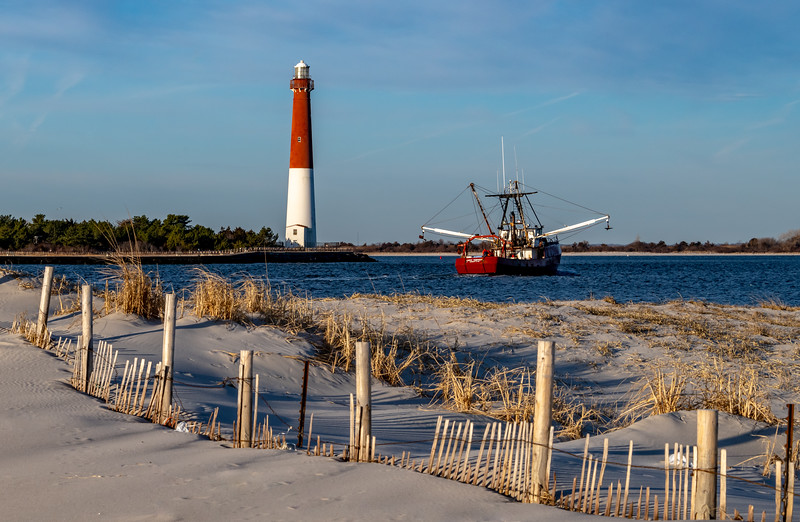 A Fishing Boat Passing In Front Of Barnegat Lighthouse 2/17/19