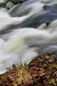 Water from Alley Spring rushes down rocks.  Photo by Kyle Spradley | www.kspradleyphoto.com