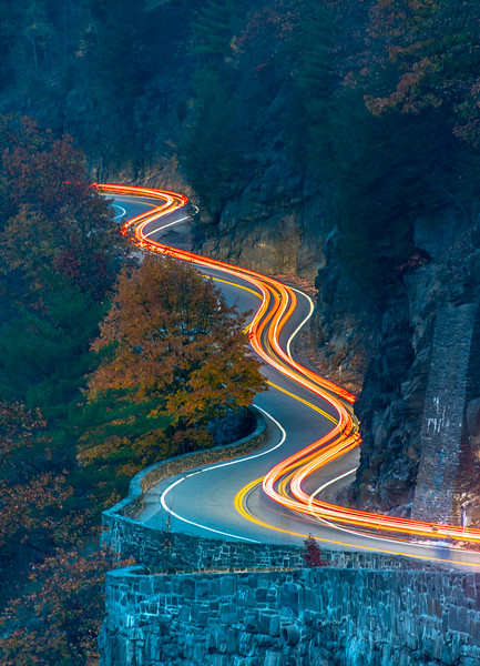Car Trails Along Hawk's Nest Winding Road Surrounded By Autumn Colors 10/22/20