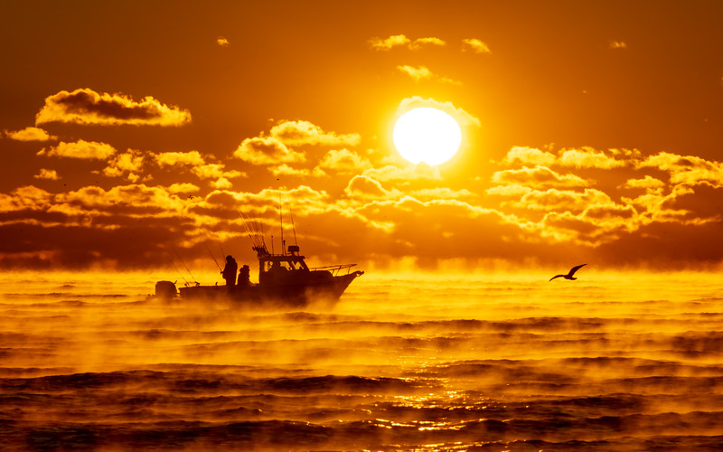 Boat Passing In Front of Rising Sun with Sea Smoke on Ocean 11/23/18