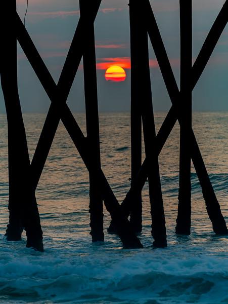 Sunrise Through Pier Poles On Belmar Beach 7/8/20