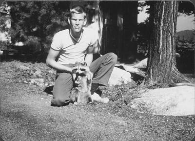 "Robert ""Hamie"" Hamilton with adopted raccoon, Judy"