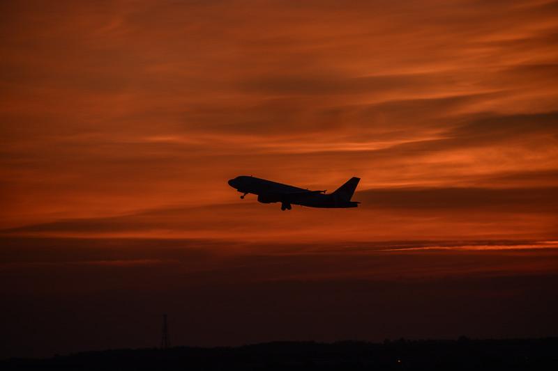 A Plane Taking Off at Sunrise, Orlando, FL