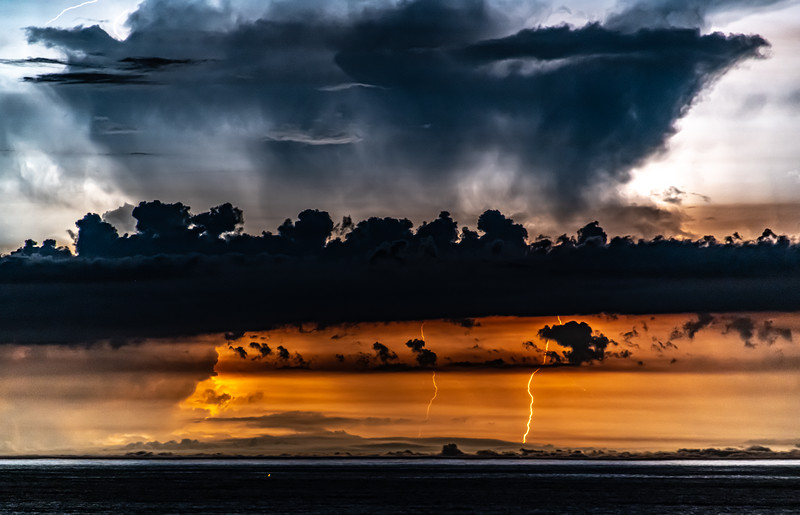 An anvil cloud lit up by lightning as the thunder storm cell moves out to sea 7/29/20