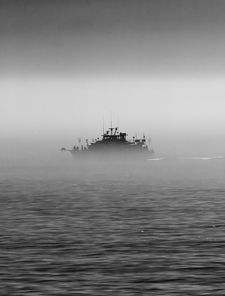 A Fishing Boat Passing Through The Morning Fog Over The Ocean 6/21/20