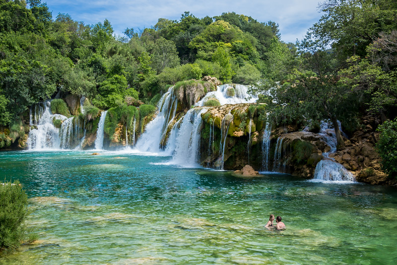 A couple swimming in a lake in Krka Falls, Croatia. The sights were stunning and lots of swimmers were jumping in the natural lakes! Crazy scenery. Plitvice Lakes was better and that's saying a lot.