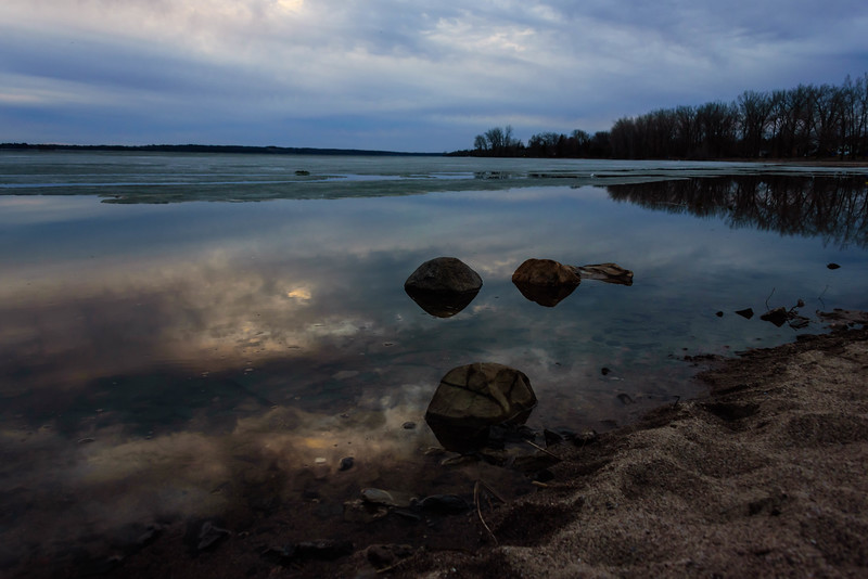 Calm icy water rage sky