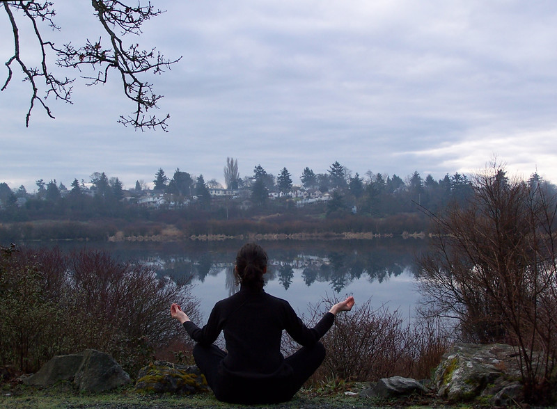 A young woman meditates at a lake<br /> <br /> Professional Nature Photography by Christina Craft of the Nature Stock Photography Library
