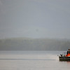 Ecotourism - fishing boat in the rain - Stock Photo by Nature Photographer Christina Craft