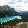 Peyto lake - a tourist and photographer takes a photo of peyto lake in alberta's rocky mountains in banff national park