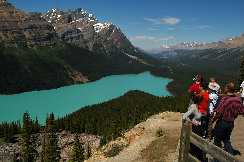 People /Tourists looking at Peyto Lake near Lake Louise in Banff National Park - Rocky Mountain landscape mountains scenic landscape - Photograph by professional nature stock photographer Christina Craft