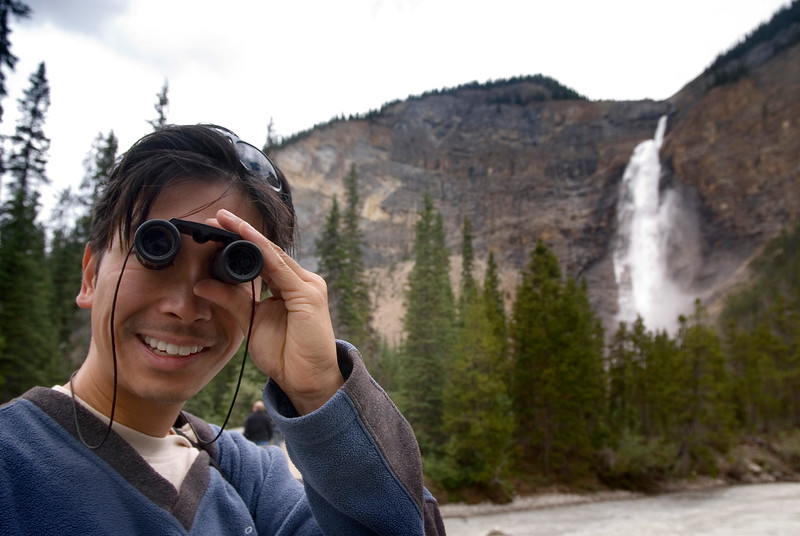 A tourist with binoculars - clowns for camera - eco tourism - in mountains