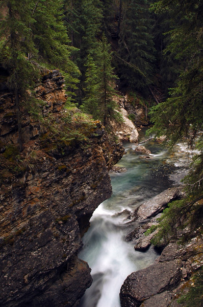 Canyon with rapids in a river - long exposure for motion blur of waterfalls Rocky Mountain landscape mountains scenic landscape - Photograph by professional nature stock photographer Christina Craft