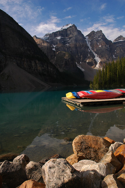 Kayaks on Moraine Lake in the Rockies - Rocky Mountain landscape mountains scenic landscape - Photograph by professional nature stock photographer Christina Craft