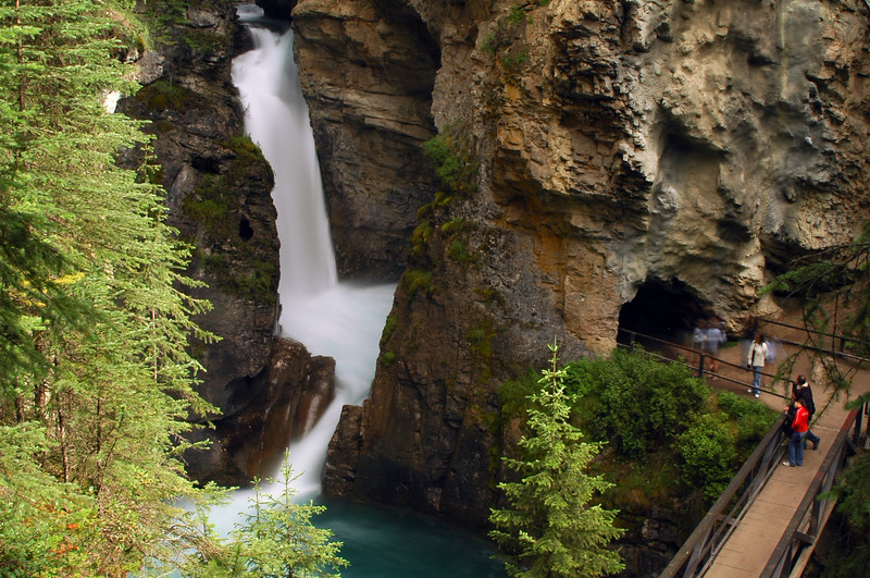 Johnston Canyon - tourists look over a bridge at the waterfalls Rocky Mountain landscape mountains scenic landscape - Photograph by professional nature stock photographer Christina Craft
