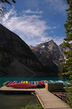 Tourism - Kayaks at the end of a dock - Rocky Mountain landscape mountains scenic landscape - Photograph by professional nature stock photographer Christina Craft