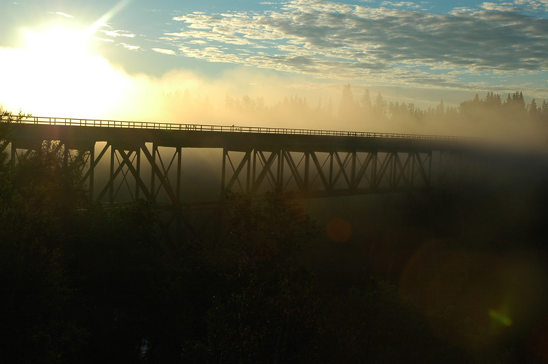 Bridge surrounded in fog with lens flare sunrise or sunset dusk or dawn - Nature Stock Image by Professional Nature Photographer Christina Craft