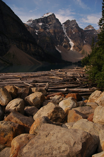 Morraine Lake - near Lake Louise rocks and lake Rocky Mountain landscape mountains scenic landscape - Photograph by professional nature stock photographer Christina Craft