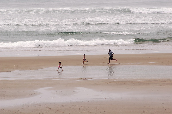 Family playing on the beach Oregon USA - American Coastlines - by Nature Photographer Christina Craft - Thousands of nature and wildlife photos available here in the Nature & Wildlife Photo Library.