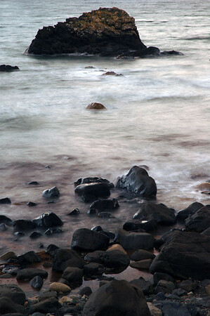 Rocks with waves photographed at a long exposure so there is motion blur - beach scene - Nature Stock Image by Professional Nature Photographer Christina Craft