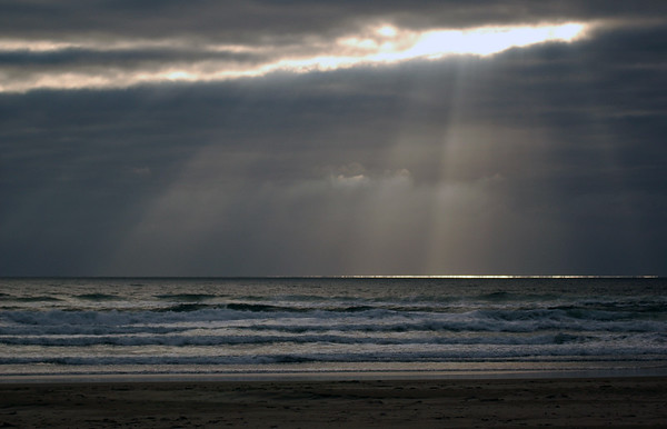 God rays - sun rays streaming down through the clouds onto the ocean beach - Nature Stock Image by Professional Nature Photographer Christina Craft