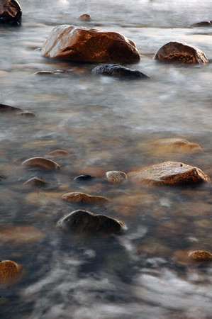 coastal scenic - rocks and motion blur with water (long exposure) on a beach showing the tides - Nature Stock Image by Professional Nature Photographer Christina Craft
