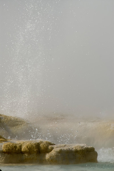 A geyser is a type of hot spring that erupts periodically, ejecting a column of hot water and steam into the air. This Geyser is in Yellowstone National Park.