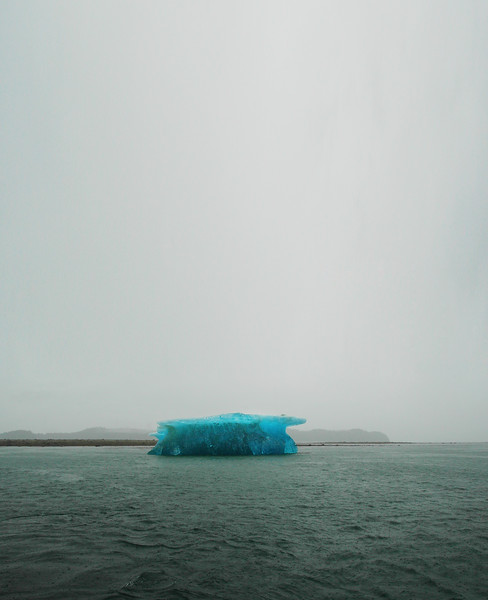Vertical image of an iceberg centered Stock Photo by Nature Photographer Christina Craft