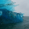 Closeup of a crystal clear blue iceberg in Alaska - Stock Photo by Nature Photographer Christina Craft