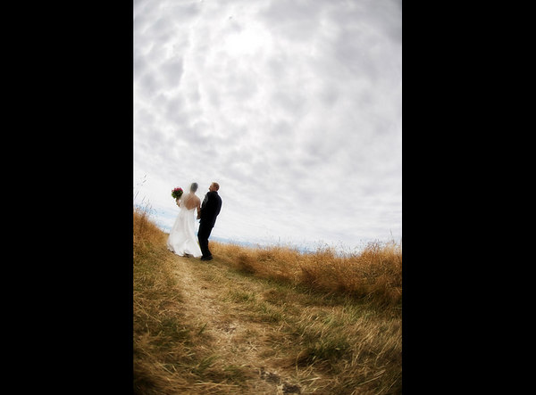 This couple is actually fairly close to me (only a few feet away) and, by turning the fisheye vertically, allows the pattern in the sky and field to create a neat canvas for the scene.